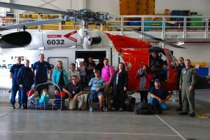 Military families are treated to a VIP tour of a Coast Guard Air Station during a Heroes Retreat.