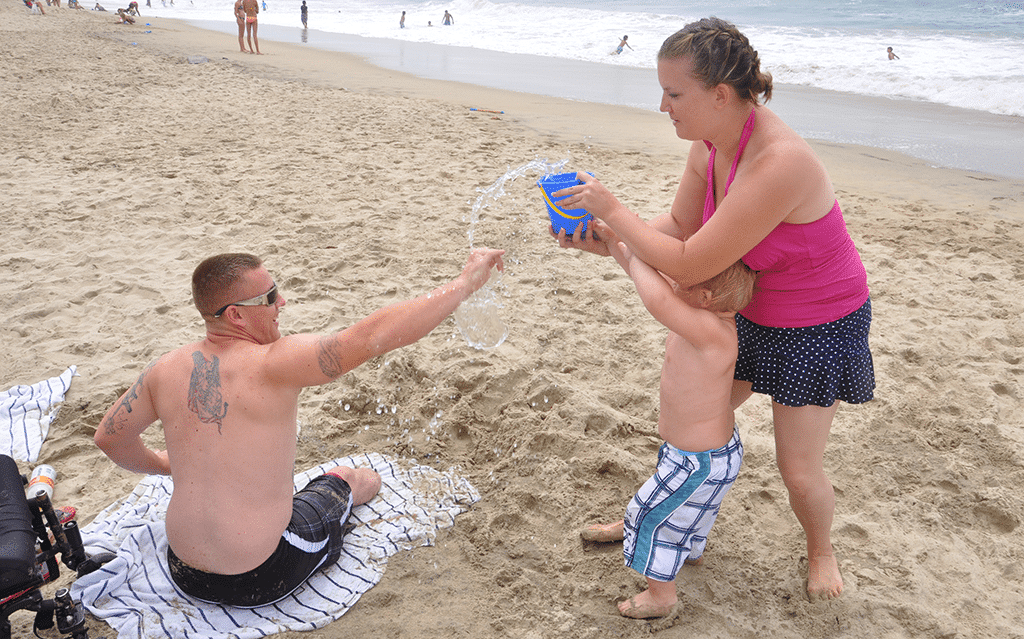 Marine Corporal Larry Draughn plays with his son and wife in Huntington Beach, California.