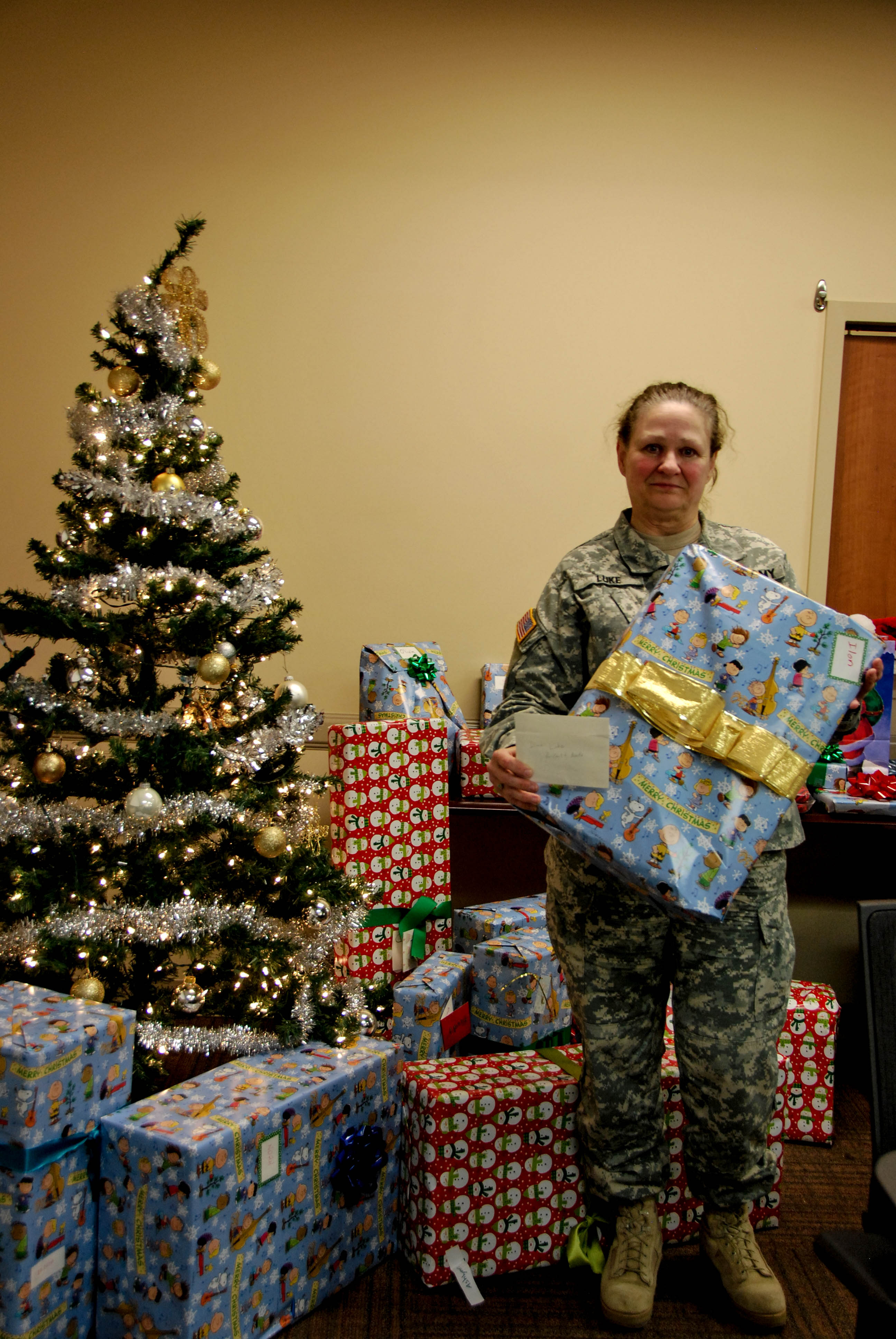 A soldier with Christmas presents for our Troops and their Families