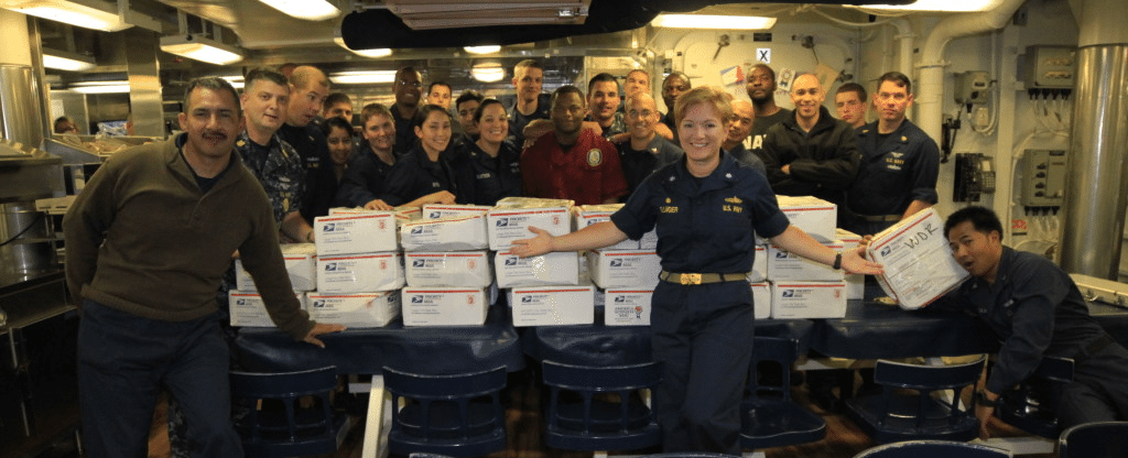 Sailors aboard the USS Kidd receive care packages from Freedom Alliance