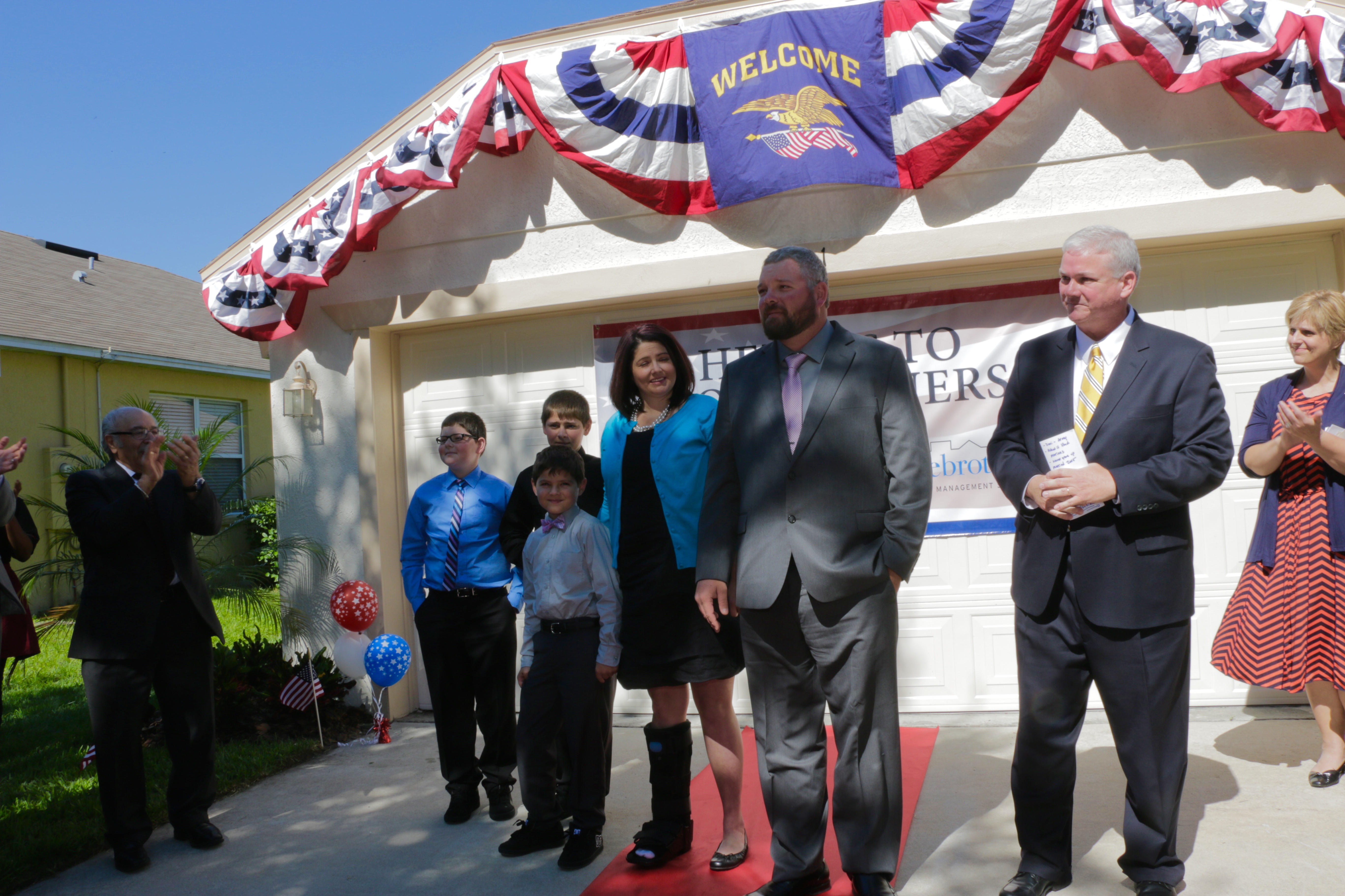 Cory Lewis and his family are presented with a new home in Apopka, Florida