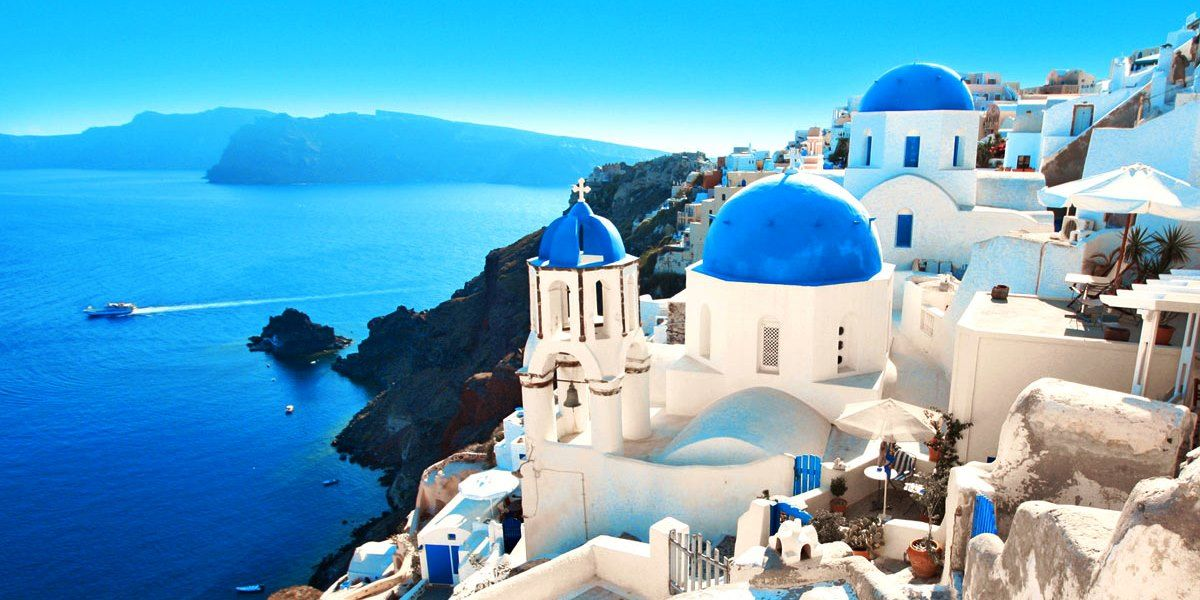 The white buildings of Santorini Greece overlooking the beautiful sea.