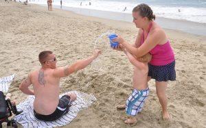 Military family enjoy a Freedom Alliance retreat at the beach