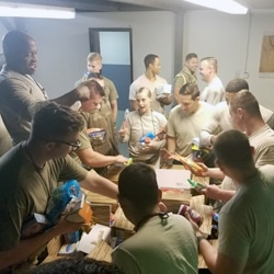 Deployed Service Members open Freedom Alliance Gifts from Home care packages